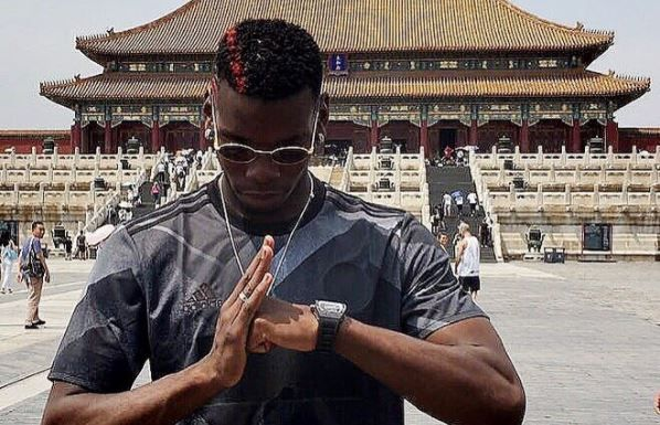 Paul Pogba poses at the Forbidden City in China