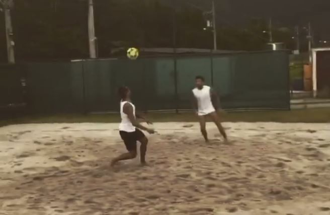 Neymar and Dani Alves enjoy a game of futvolei on the beach