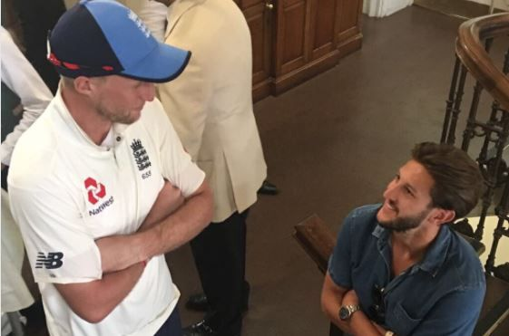 Liverpool's Adam Lallana meets England cricket captain Joe Root at Lord's