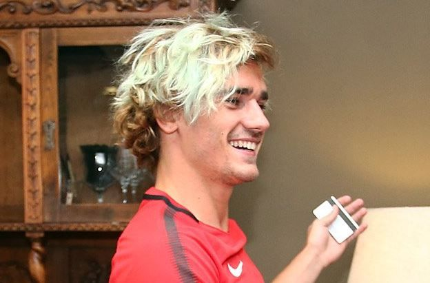 Antoine Griezmann reports for Atletico Madrid preseason training with an eye-catching hairdo