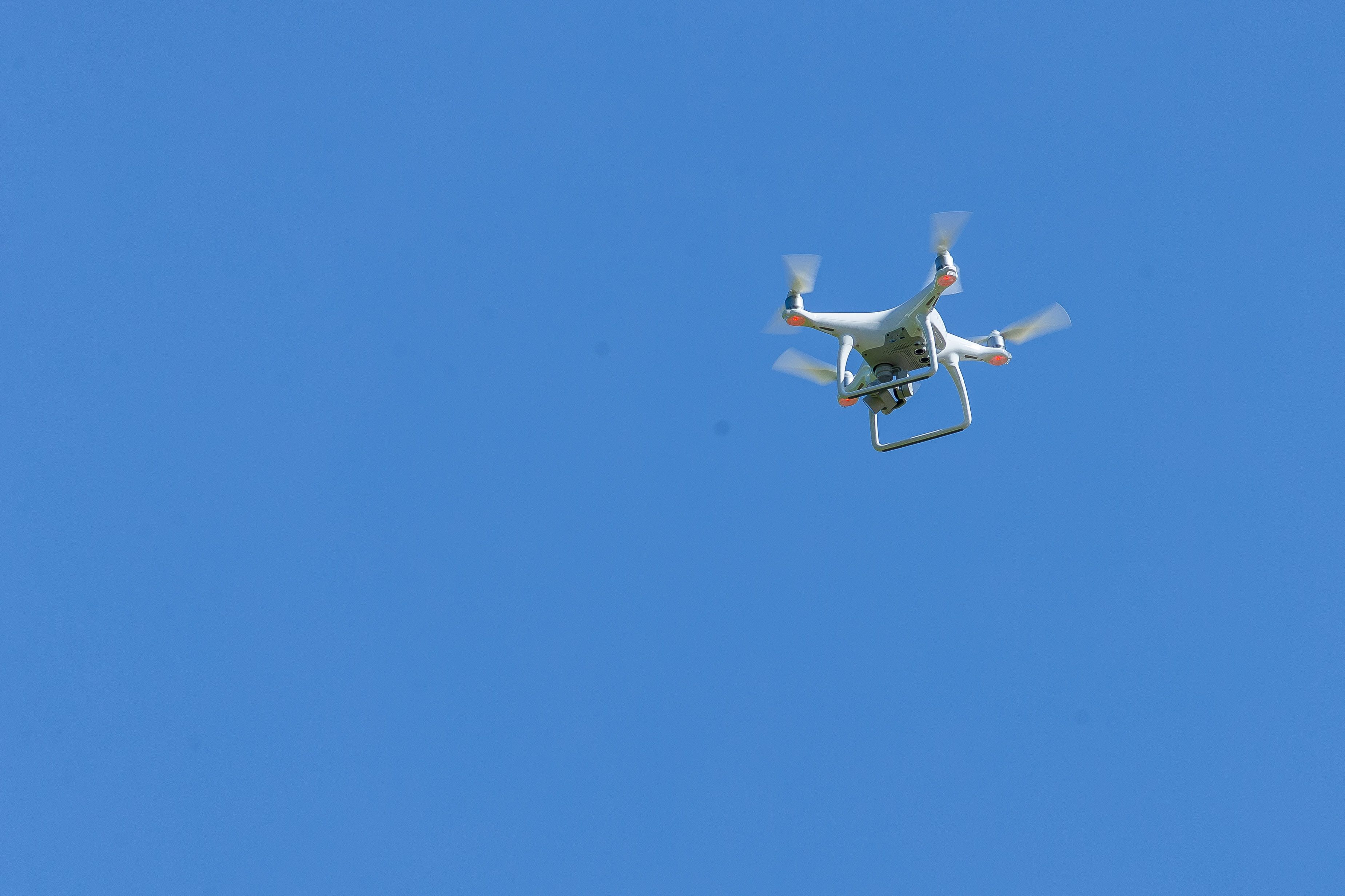 A drone hovering over the crowd