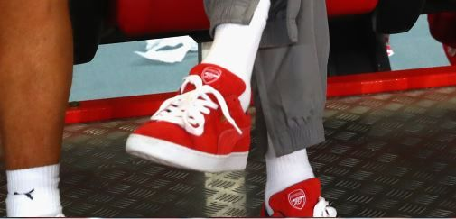 Arsene Wenger wears Arsenal branded footwear during ICC match vs. Bayern in China