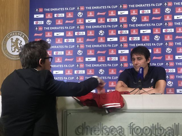 Chelsea manager Antonio Conte presented with Manchester United shirt at news conference