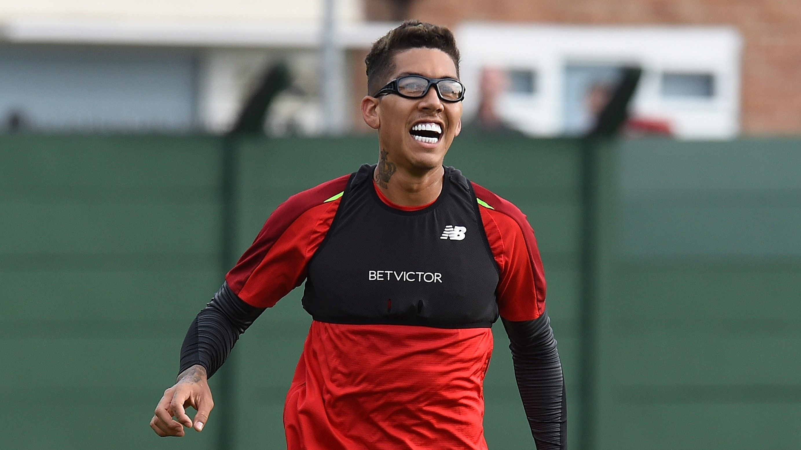 Liverpool's Roberto Firmino wears goggles to a training session.