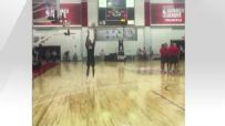 Russell hits trick shot 3-pointer