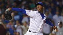 Chapman finishes off White Sox to earn first save with Cubs