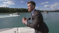 Marty Smith attempts pass to water skier