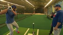 Arrieta shows off at batting practice