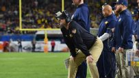 Harbaugh tries to emulate Ohio State legend