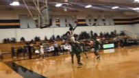 Texas high schooler makes a pro-sized poster dunk