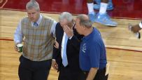 Roy Williams collapses in the huddle