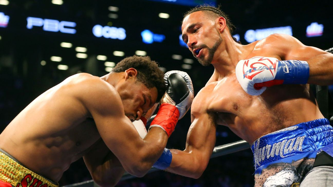 Thurman outslugs Porter to retain title in thriller
