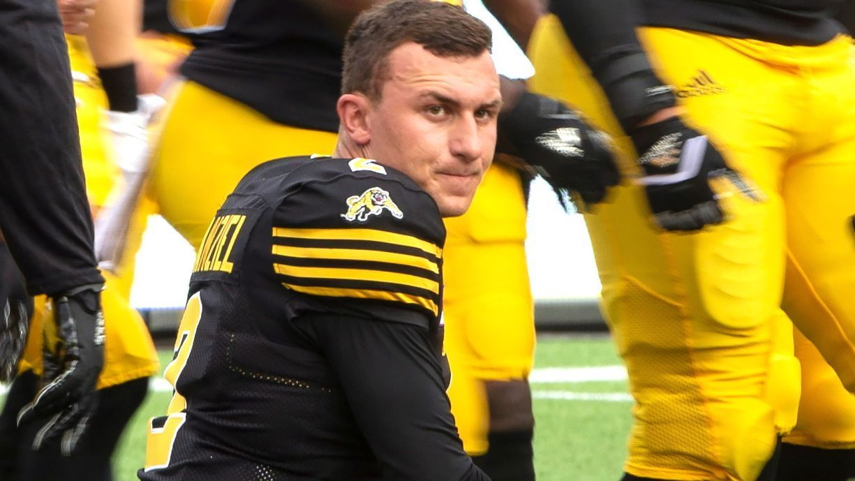 Johnny Manziel never made it off the sideline in Hamilton's regular-season opener, looking on as starter Jeremiah Masoli played in the Tiger-Cats' 28-14 loss to the Calgary Stampeders on Saturday night.
