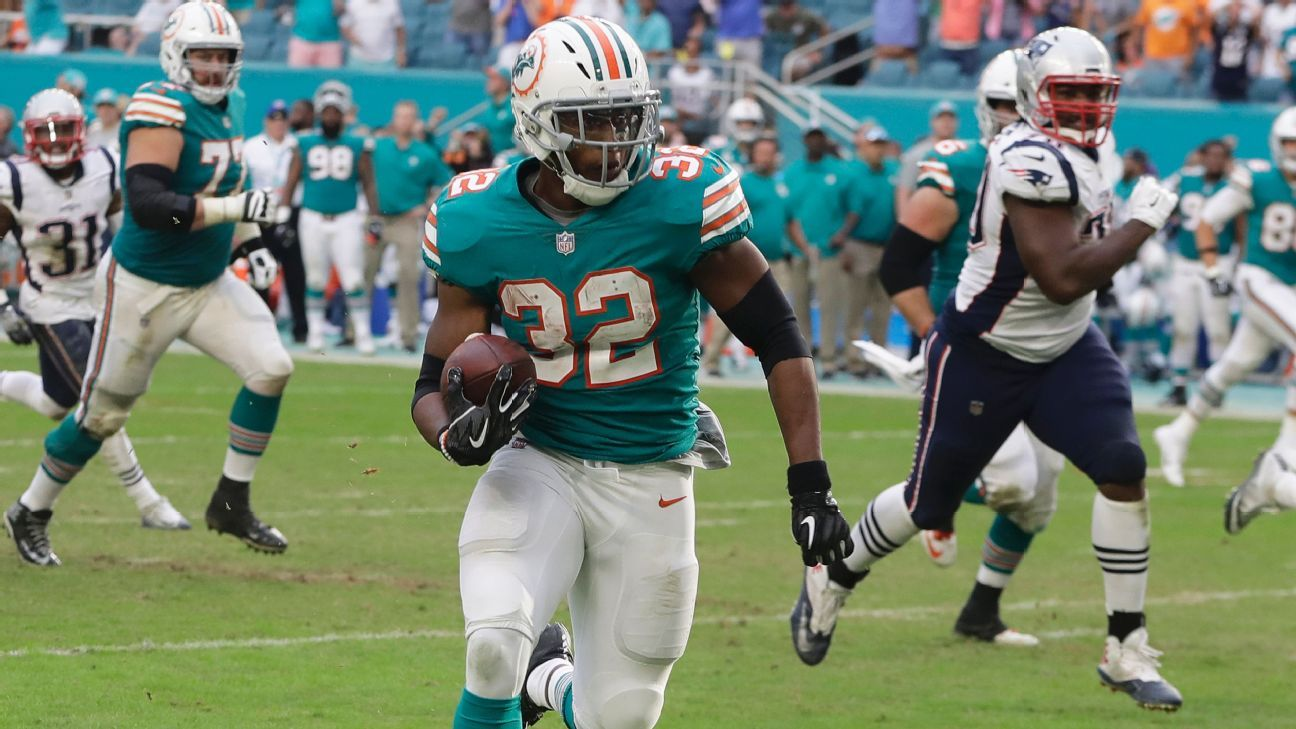 Kenyan Drake sprinted the last 52 yards as the Dolphins scored on a crazy pass and double lateral on the final play Sunday to beat the New England Patriots 34-33 and keep their playoff hopes alive.