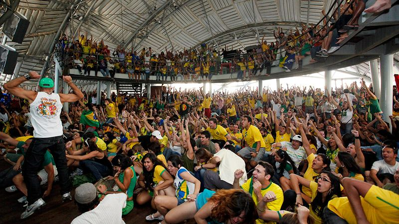 Brazilian supporters in Rio de Janeiro watch their team defeat Chile in the World Cup. 