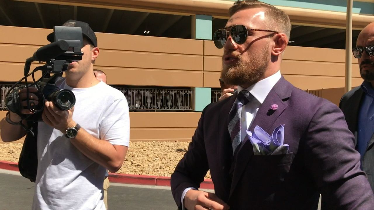 McGregor arrives in flashy purple suit