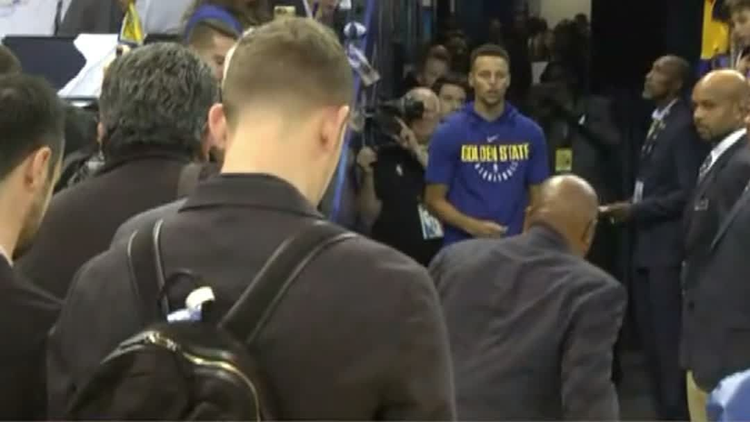 Curry hits from tunnel in pregame
