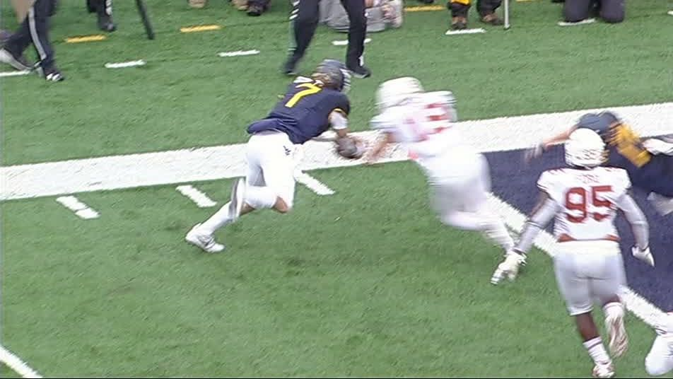 Grier injured diving for pylon