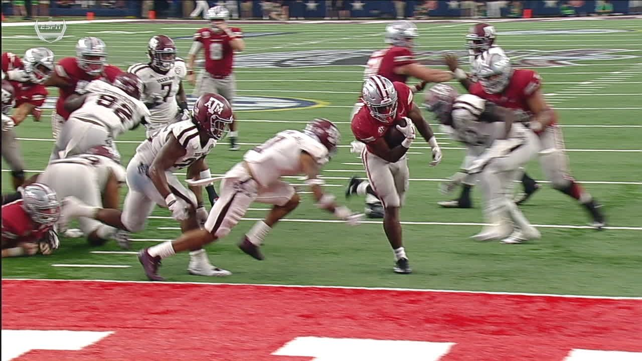 Razorbacks' Williams pushes through the end zone for TD