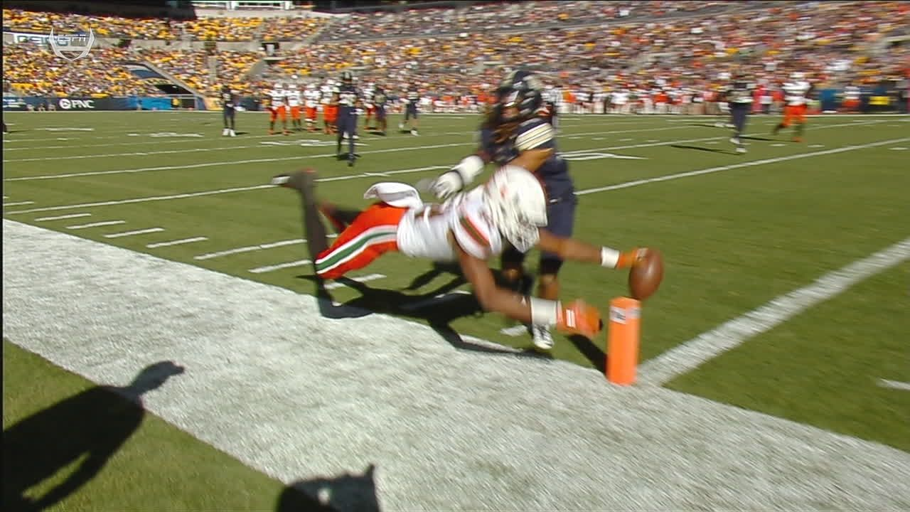 Miami's Richards extends for the TD