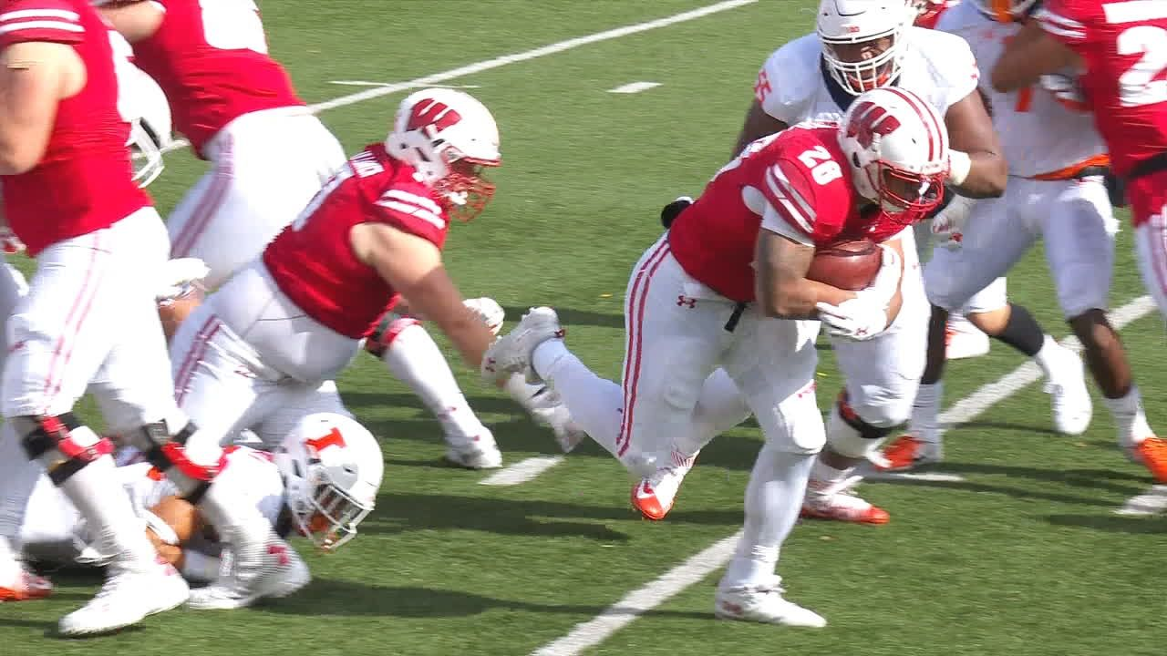 Taylor and Deal carry No. 23 Wisconsin past Illinois 49-20