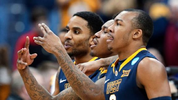 Cats Pounce On WVU