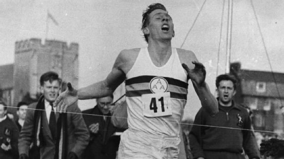 Roger Bannister crosses the line to break the four-minute mile