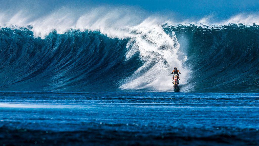 dirt bike surfing the ocean