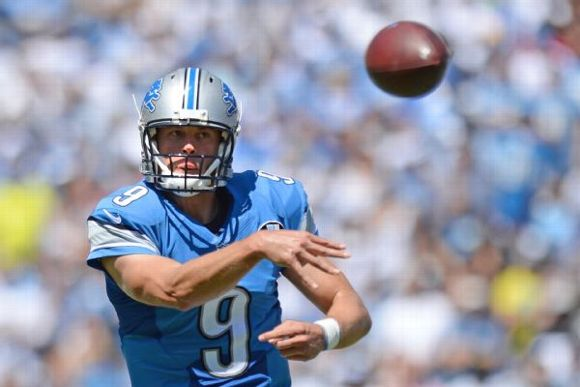 matthew stafford of detroit lions says he 39 ll be ready for sunday after hurting arm espn. Black Bedroom Furniture Sets. Home Design Ideas