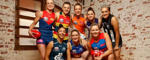 Players show off their new AFL Women s uniforms. ee0f57d1f