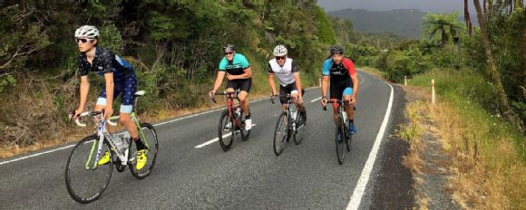 Lance Armstrong rides along Scenic Drive with local cyclists in Auckland's Waitakere Ranges on December 19, 2016.
