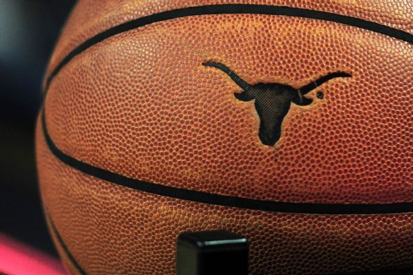 Andrew Jones practicing with Texas after leukemia treatments