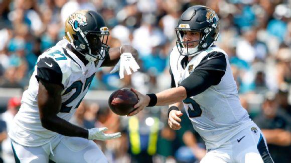 Jacksonville Jaguars quarterback Blake Bortles (5) hands off to  running back Leonard Fournette (27)