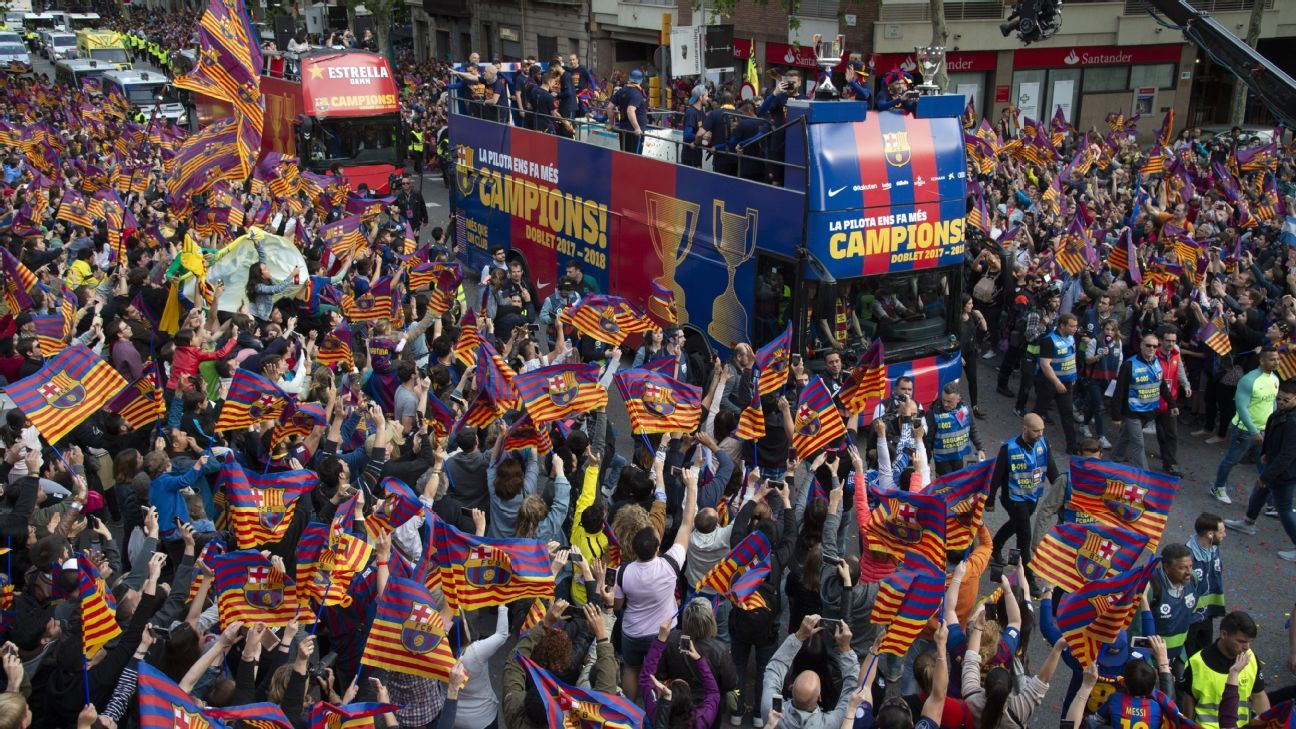 Barcelona celebrate La Liga and Copa del Rey trophies with parade