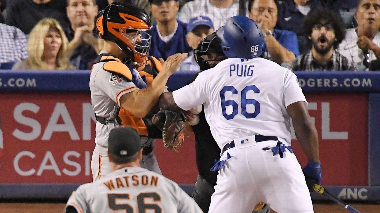 Yasiel Puig and Nick Hundley are expelled after putting together a fight that emptied benches