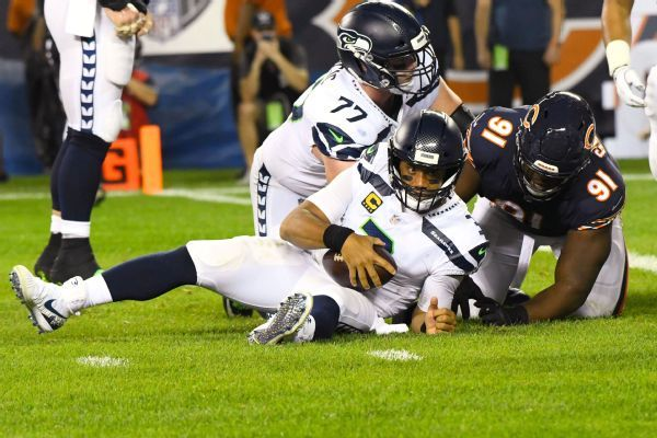 Playcalling and constant pressure on Russell Wilson put Seattle in 0-2 hole