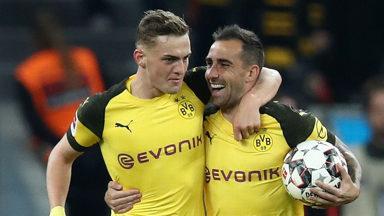 Dortmund go top of Bundesliga with four-goal rally past Bayer Leverkusen