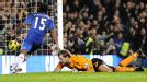 Jussi Jaaskelainen looks on as Chelsea's Florent Malouda scores