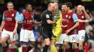 Lee Mason rejects the protestations of the Aston Villa players after awarding Chelsea a penalty