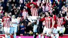 Stoke's Danny Higginbotham jumps for joy after scoring his team's second goal.