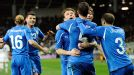 Thiago Motta (5) is mobbed after scoring Italy's 73rd minute winner in Slovenia.