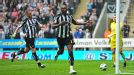 Shola Ameobi celebrates after opening the scoring from the penalty spot