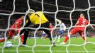 Wales goalkeeper Wayne Hennessey can't stop Ashley Young's shot