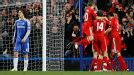 Liverpool celebrate their second goal while Chelsea's David Luiz stands dejected