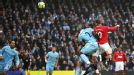 Wayne Rooney scores Man United's first with a fine header