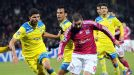 Lyon forward Lisandro Lopez struggles to find space against APOEL Nicosia
