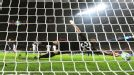 Christian Abbiati is helpless to stop Lionel Messi's first penalty of the night.