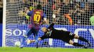 Lionel Messi beats Christian Abbiati's outstretched hand to give Barcelona the lead.