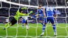 John Terry clears off the line from Rafael van der Vaart's effort