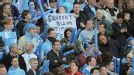 City fans at Eastlands hold up a sign highlighting the significance of the match